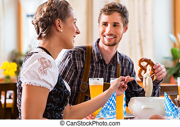 Man and woman eating in bavarian restaurant