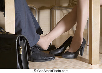 Man and woman flirting while a business meeting