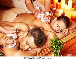 Man and woman getting herbal ball massage in spa. - Man and...