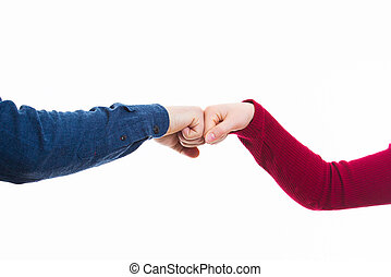 Man and woman giving fist bump