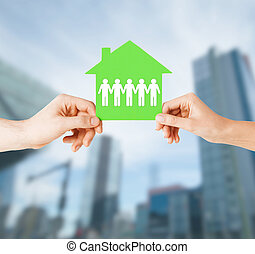 man and woman hands with paper house