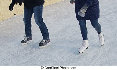 Man and woman have fun skating rink outdoor in winter. Video...