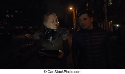 Man and woman having a talk when walking in winter evening