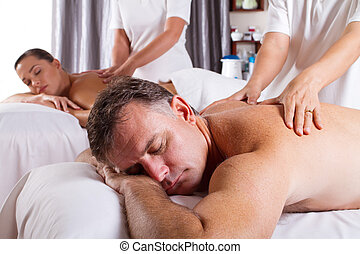 man and woman having massage
