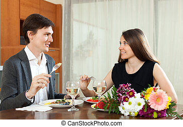 Man and woman having romantic dinner