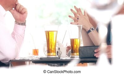 Man and woman having table conversation at the restaurant