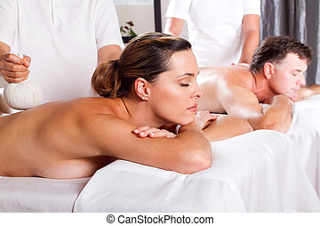 Thai massage - man and woman having Thai massage