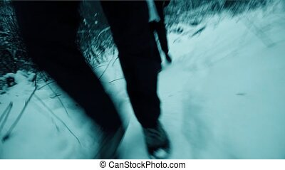 Man and woman hiking in winter forest. Steadicam shot - Man...