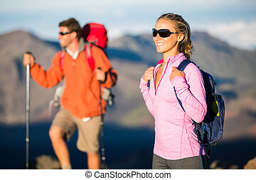 89eb16dfd4bd5d Trekking and backpacking in the mountains. Healthy lifestyle outdoor  adventure concept. Man and woman hiking on beautiful mountain trail