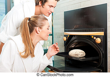 Man and woman in a bread sauna