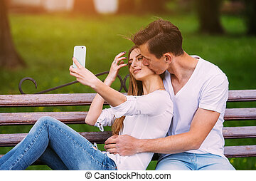 man and woman in a park make selfie