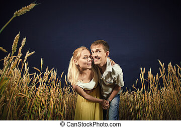 man and woman in a wheat field