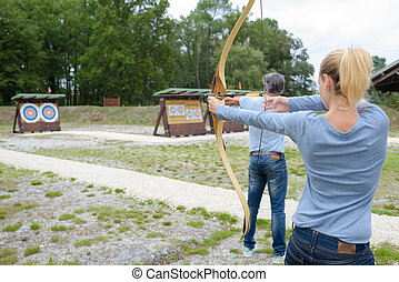 Man and woman in archery training