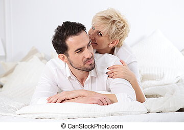 Man and woman in bed.