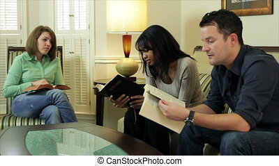 man and woman in bible study