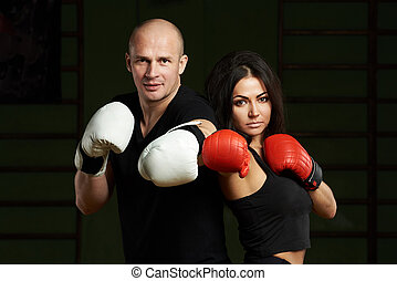 Man and woman in boxing golves