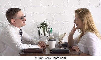 Man and woman in formal wear at coffee break in the cafe.
