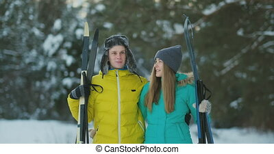 Man and woman in love with ski equipment going to ski...