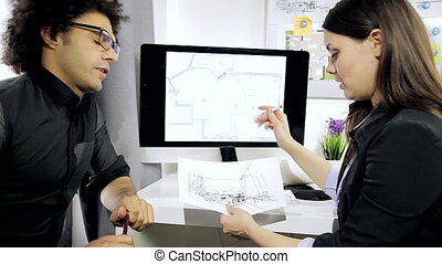 Man and woman in office working
