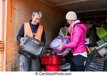 Man and woman in recycling center