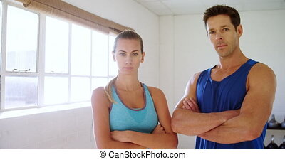 Man and woman in sportswear looking at camera 4k