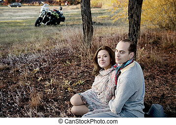Man and woman in the forest autumn