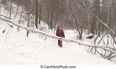 Man and woman in the winter forest