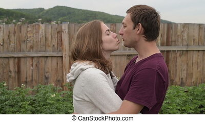 Man and woman kiss each other