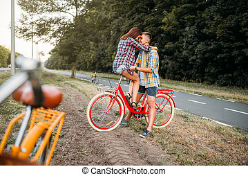 Man and woman kissing on retro bike