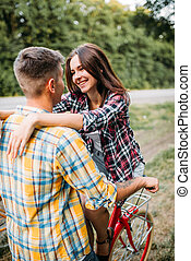 Man and woman kissing, romantic date, retro bikes