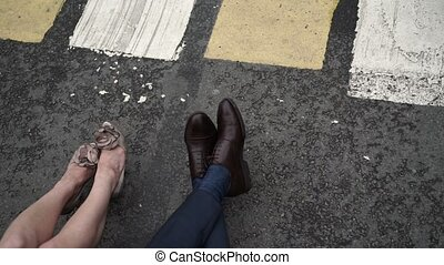 Man and woman legs on a street