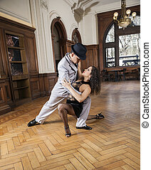 Man And Woman Looking At Each Other While Performing Tango
