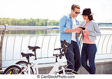 Man and woman looking at smartphone