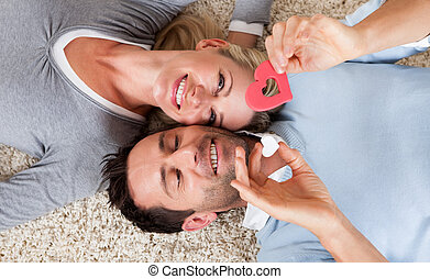 Man and woman lying head to head on the carpet