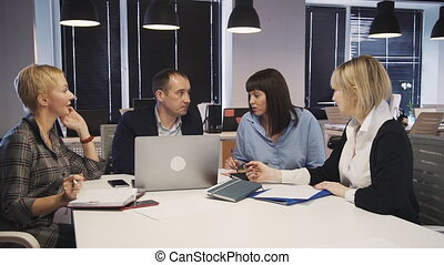Man and woman making brainstorming research in boardroom -...