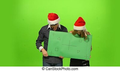 man and woman: new year's eve. green screen, blank sign