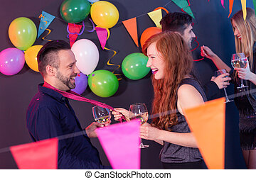 Man and woman on a party