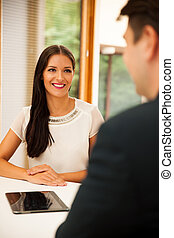 Man and woman on business meeting, sitting in the office, discussing the solutions