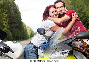 man and woman on motorcycles