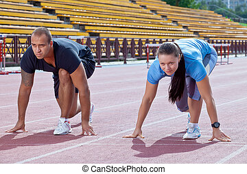 Man and woman on the starting line