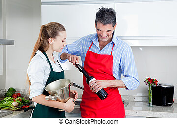 Man and Woman Opening Wine Bottle