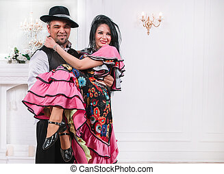 man and woman performing a quick Gypsy dance