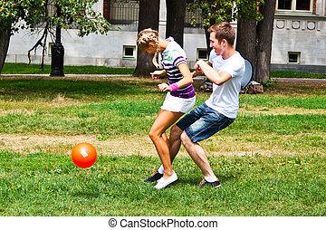 man and woman playing football