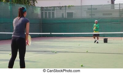 Man and woman playing tennis, sport