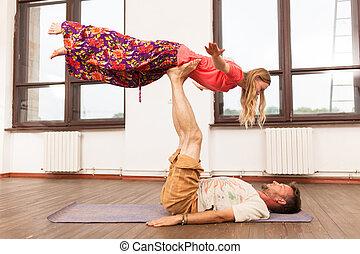Man and woman practicing partner yoga