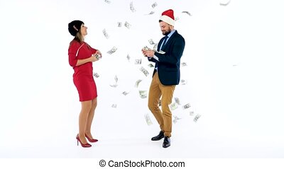 Man and woman received cash bonuses for Christmas, rejoice and throw money. Let's go celebrate concept. Slow motion