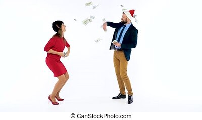 Man and woman received cash bonuses for Christmas, rejoice and throw money. Let's go celebrate concept.