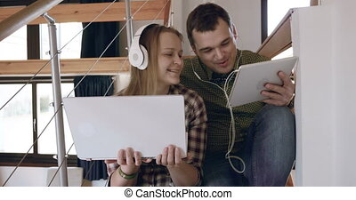 Man and woman relaxing with music at home