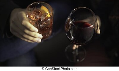 Man and woman s hands with glasses of alcohol