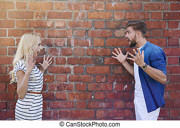 Man and woman screaming on each other